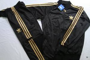 new arrival 9ca93 625af Brand New Men s Adidas Tracksuit Black with Gold Stripes - Australia - Free  Classifieds - Muamat