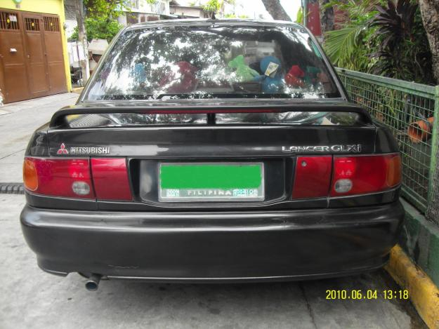 Black colour(1993) model Mitsubishi Lancer car for sale - Islamabad
